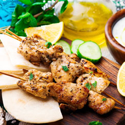 Grilled lemon & herb chicken skewers with steamed greens photo