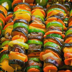 Grilled beef & Mediterranean vegetable skewers photo