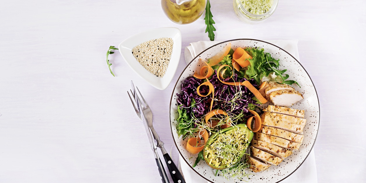 Poached chicken spring salad with avocado photo