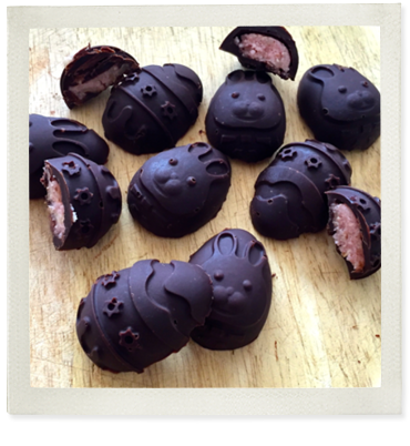 Strawberry filled dark chocolate Easter Egg photo