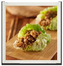 Warm Thai chicken lettuce wraps photo