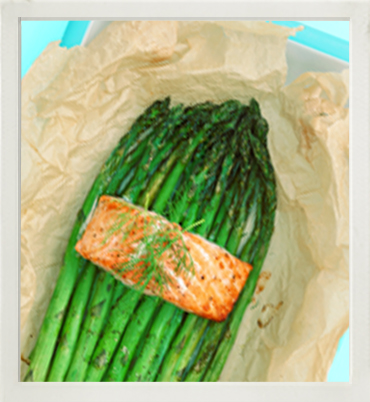 Steamed salmon parcels with fresh asparagus photo