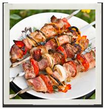 Grilled beef & Mediterranean vegetable skewers photo